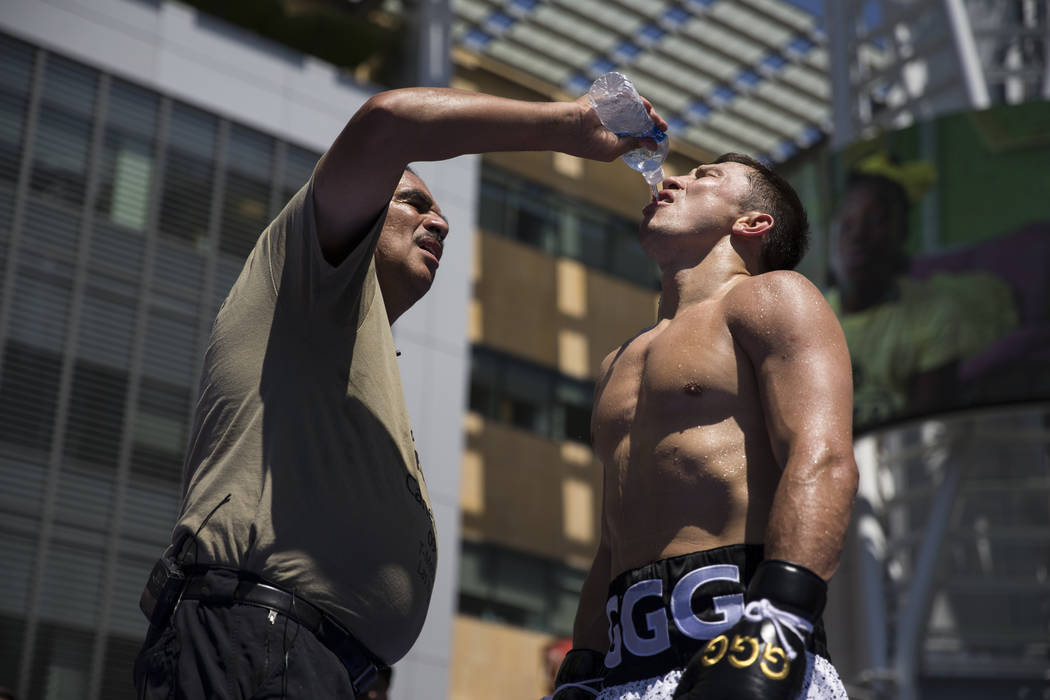 Gennady Golovkin, right, gets a drink of water from his trainer Abel Sanchez during a media workout at L.A. Live in Los Angeles, Calif., on Monday, Aug. 28, 2017. Erik Verduzco Las Vegas Review-Jo ...