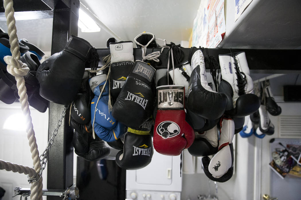 "A collection of boxing gloves at The Summit Gym in Big Bear, Calif., where boxer Gennady Golovkin is preparing for his September 16 bout against Saul ""Canelo"" Alvarez, on Wednesd ..."