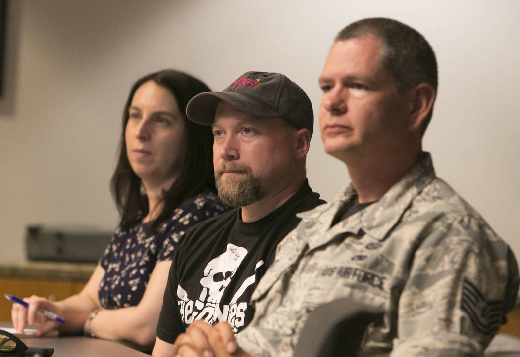 U.S. Air Force TSgt Jeremy Ortiz, right, Chad Roger, and Stacy Taylor, left,  attend a seminar to learn how to prepare for emergencies of all types at the Government Center in Las Vegas, Friday, S ...