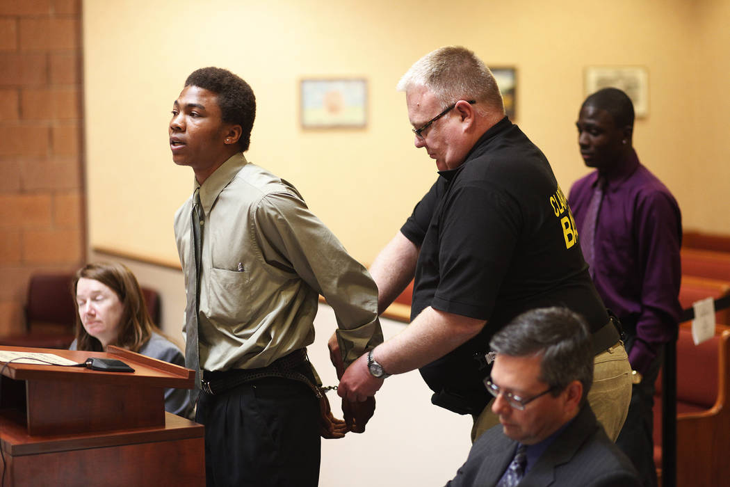 Bailiff Jered Pace removes handcuffs from Lamar Lewis in North Las Vegas Justice Court in North Las Vegas Tuesday, Feb. 25, 2014. Lewis is in a special new diversionary court for non-violent defen ...
