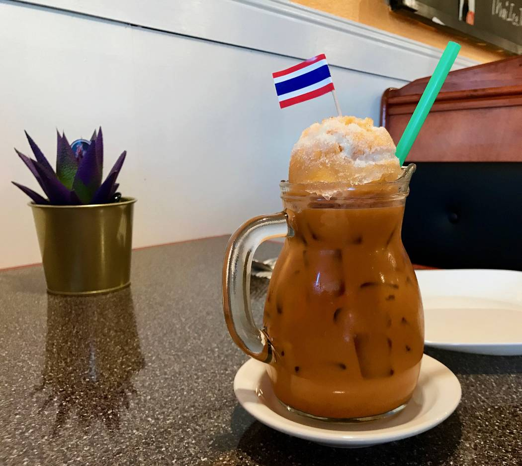 A 24-ounce Thai tea at Chucote Thai Bistro and Desserts, garnished with shaved ice and condensed milk and topped with the national flag of Thailand ($3.50). (Madelyn Reese/View) @MadelynGReese