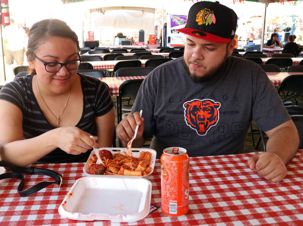 Claudia Navarro, left, and Jose Granillo enjoy a meal together during the San Gennaro Feast at Craig Ranch Regional Park, Wednesday, May 10, 2017. Gabriella Benavidez Las Vegas Review-Journal @lat ...