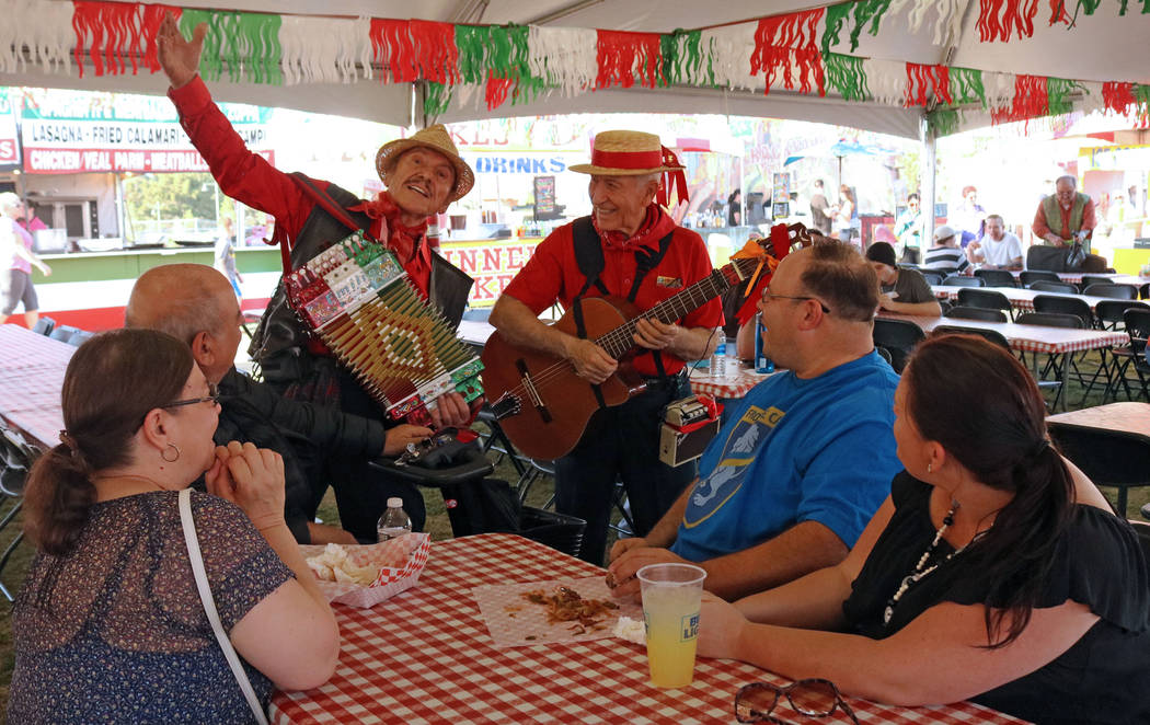 Emilio Baglioni, left, and Aldo Vallera serenade a group of people during the San Gennaro Feast at Craig Ranch Regional Park, Wednesday, May 10, 2017. Gabriella Benavidez Las Vegas Review-Journal  ...
