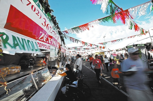 The San Gennaro Feast when it was held at the Grand Canyon Shopping Center, 4245 Grand Canyon Drive at West Flamingo Road. Food booths, rides, midway games, arts and crafts and live music are plan ...