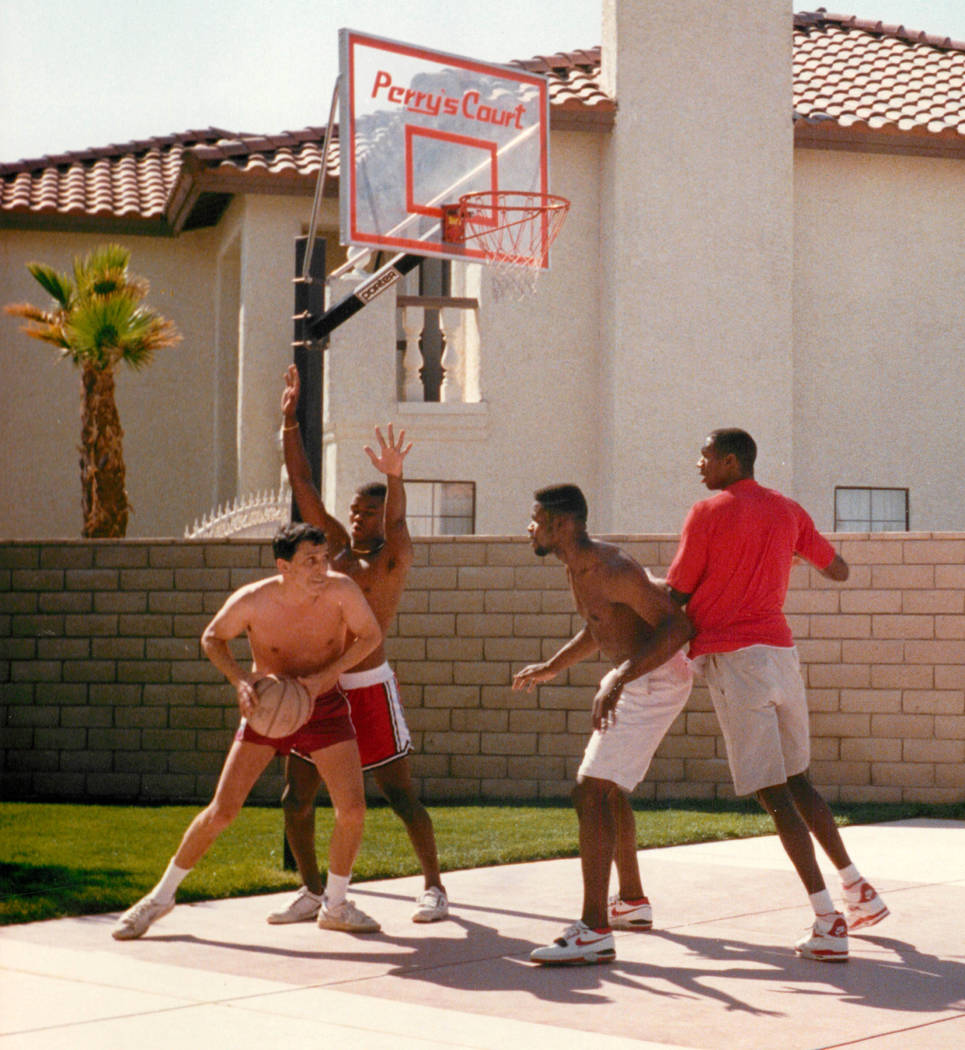 "Richard Ҕhe Fixer"" Perry, left, with UNLV players, from second from left, Anderson Hunt, Moses Scurry and David Butler in a photograph that was published in the Las Vegas Review-Journal May 26, 1 ..."