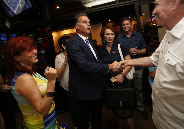 Republican Congressional District 3 candidate Danny Tarkanian, left, is greeted by Norm Ross during his election night gathering at Born and Raised in Las Vegas on Tuesday, June 14, 2016. (Richard ...