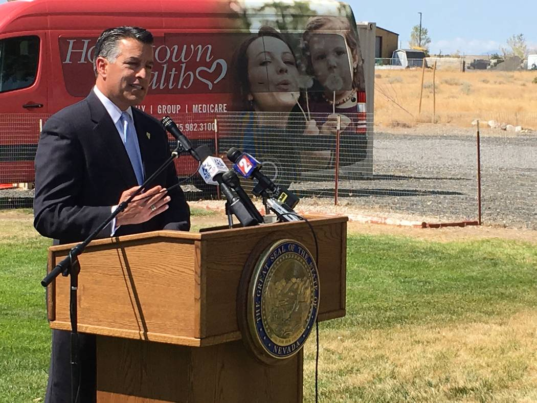Gov. Brian Sandoval, speaking outside Renown Health Urgent Care Clinic in Silver Springs on Tuesday, Aug. 15, 2017, said the 2018 carrier for rural counties will be SilverSummit, a subsidiary of C ...