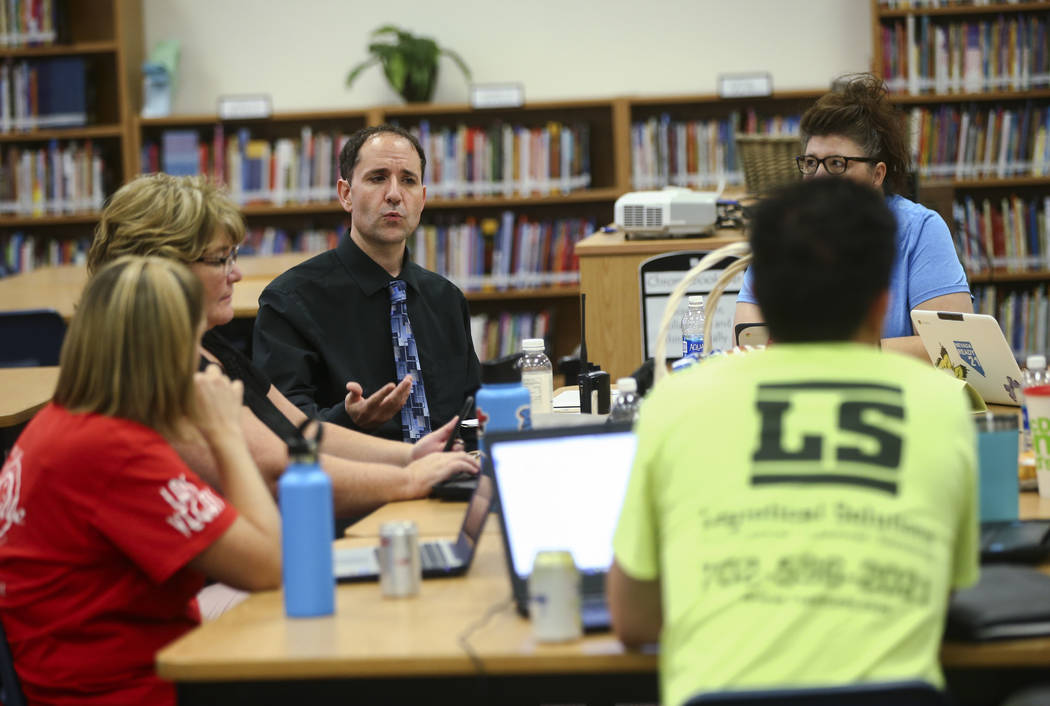 Principal Sean Davis, left, during a school organizational team meeting at Saville Middle School in Las Vegas on Tuesday, Aug. 29, 2017. The Clark County School Board approved $43 million in cuts, ...