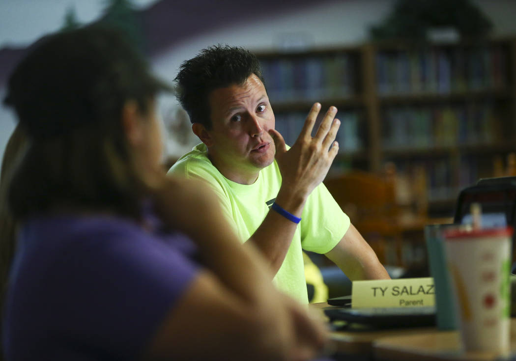 Ty Salazer, right, responds to Amy Mathewson during a school organizational team meeting at Saville Middle School in Las Vegas on Tuesday, Aug. 29, 2017. The Clark County School Board approved $43 ...