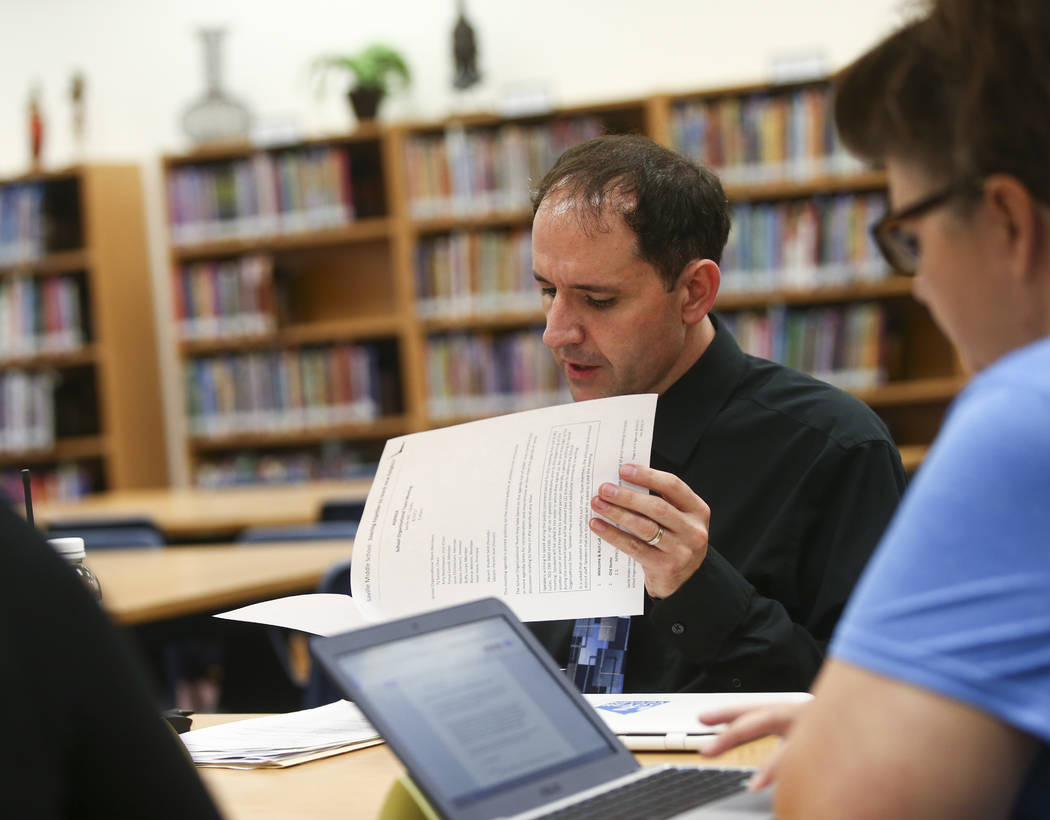 Principal Sean Davis goes over his notes during a school organizational team meeting at Saville Middle School in Las Vegas on Tuesday, Aug. 29, 2017. The Clark County School Board approved $43 mil ...