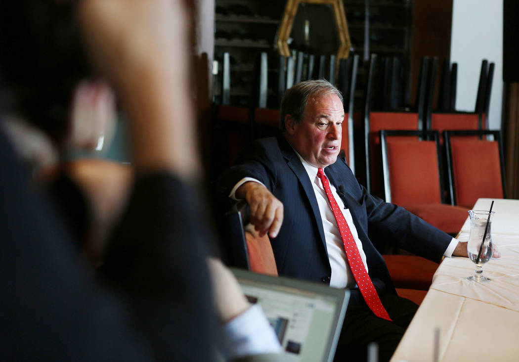Nevada Treasurer Dan Schwartz speaks to media after announcing his campaign for Governor at the Republican Men's Club monthly uncheon at Cili Restaurant at Bali Hai Golf Course in Las Vegas, Tuesd ...