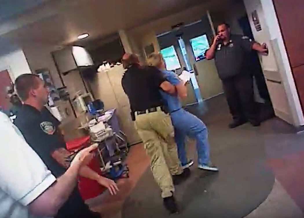 In this July 26, 2017, frame grab from video taken from a police body camera, nurse Alex Wubbels is arrested by a Salt Lake City police officer at University Hospital in Salt Lake City. (Salt Lake ...