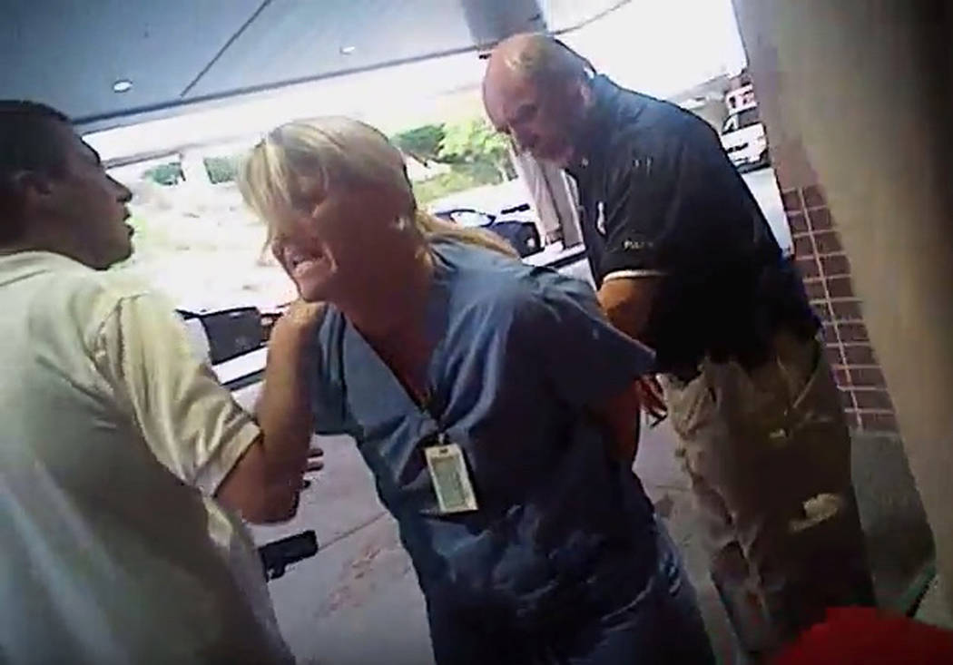In this July 26, 2017, frame grab from video taken from a police body camera, nurse Alex Wubbels is arrested by a Salt Lake City police officer at University Hospital in Salt Lake City. The Utah p ...