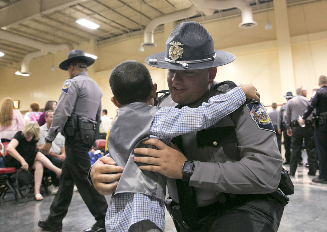 Justin Branske, of Beatty, Nev. is congratulated by his son Michael, 4, after his graduation ceremony of Nevada Highway Patrol Advanced Academy 77 at the South Point in Las Vegas on Friday, Sept.  ...