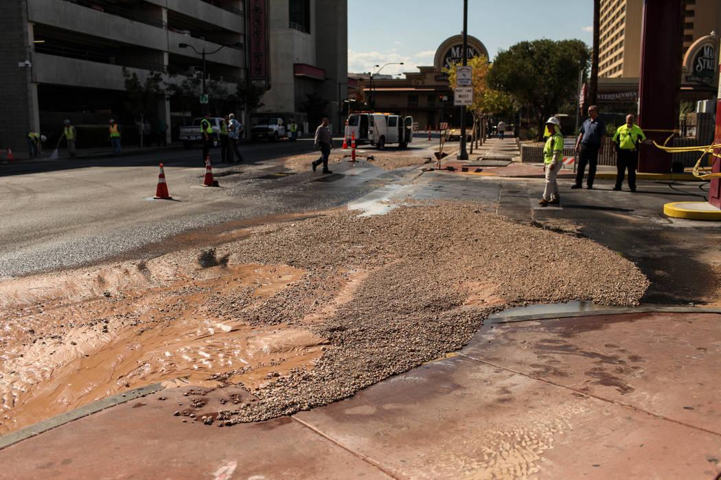 Mud and debris covers the road after a main water line broke on Stewart Avenue and Main Street in downtown Las Vegas, Friday, Sept. 1, 2017. Joel Angel Juarez Las Vegas Review-Journal @jajuarezphoto