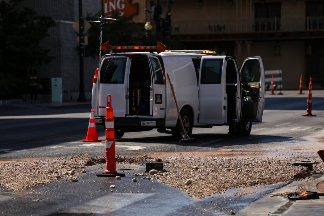 A cleanup van is parked next to the site of a main water line break on Stewart Avenue and Main Street in downtown Las Vegas, Friday, Sept. 1, 2017. Joel Angel Juarez Las Vegas Review-Journal @jaju ...
