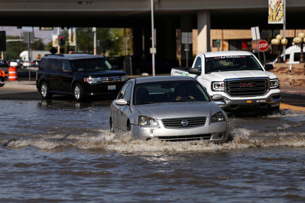 Cars drives through a flooded a road after a main water line broke on Stewart Avenue and Main Street in downtown Las Vegas, Friday, Sept. 1, 2017. Joel Angel Juarez Las Vegas Review-Journal @jajua ...