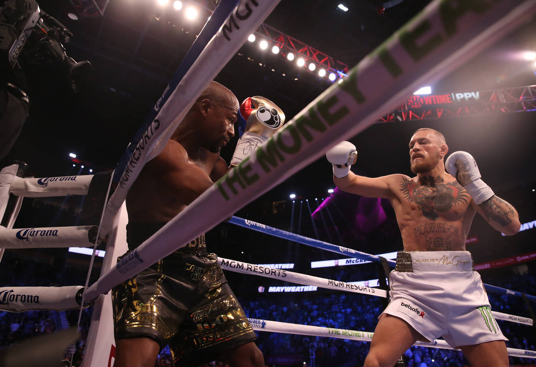 Floyd Mayweather Jr. blocks a punch from Conor McGregor during the first round of their fight at T-Mobile Arena, Saturday, Aug. 26, 2017, in Las Vegas. Benjamin Hager Las Vegas Review-Journal