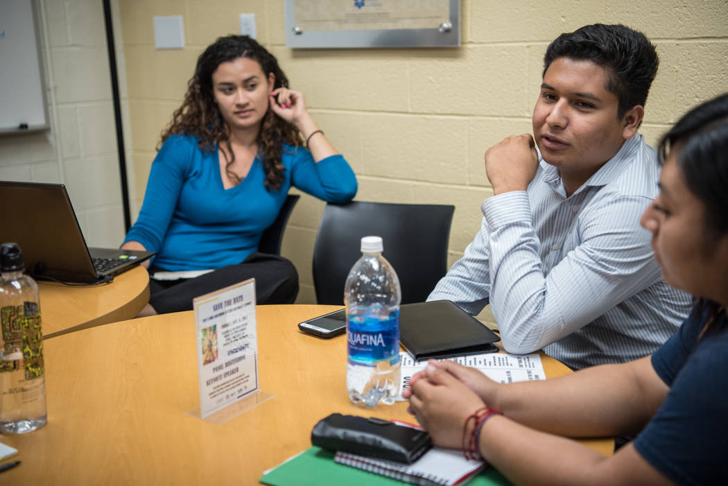 College of Southern Nevada students Cristian Aguina, left, and Jessica Duran, right, at the Generation Dreamers club meeting with teacher Esther Pla-Cazares at CSN North Las Vegas on Tuesday, Sep. ...