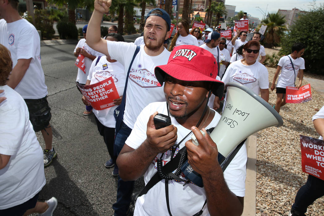 Assemblyman William McCurdy II, D-Las Vegas, leads a chant during a Fight for $15 rally and march on the Las Vegas Strip in Las Vegas, on Monday, Sept. 4, 2017. Erik Verduzco Las Vegas Review-Jour ...