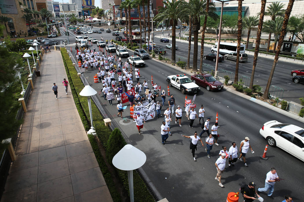 People march on the Las Vegas Strip near the Wynn Las Vegas hotel-casino during a Fight for $15 rally and march in Las Vegas, on Monday, Sept. 4, 2017. Erik Verduzco Las Vegas Review-Journal @Erik ...