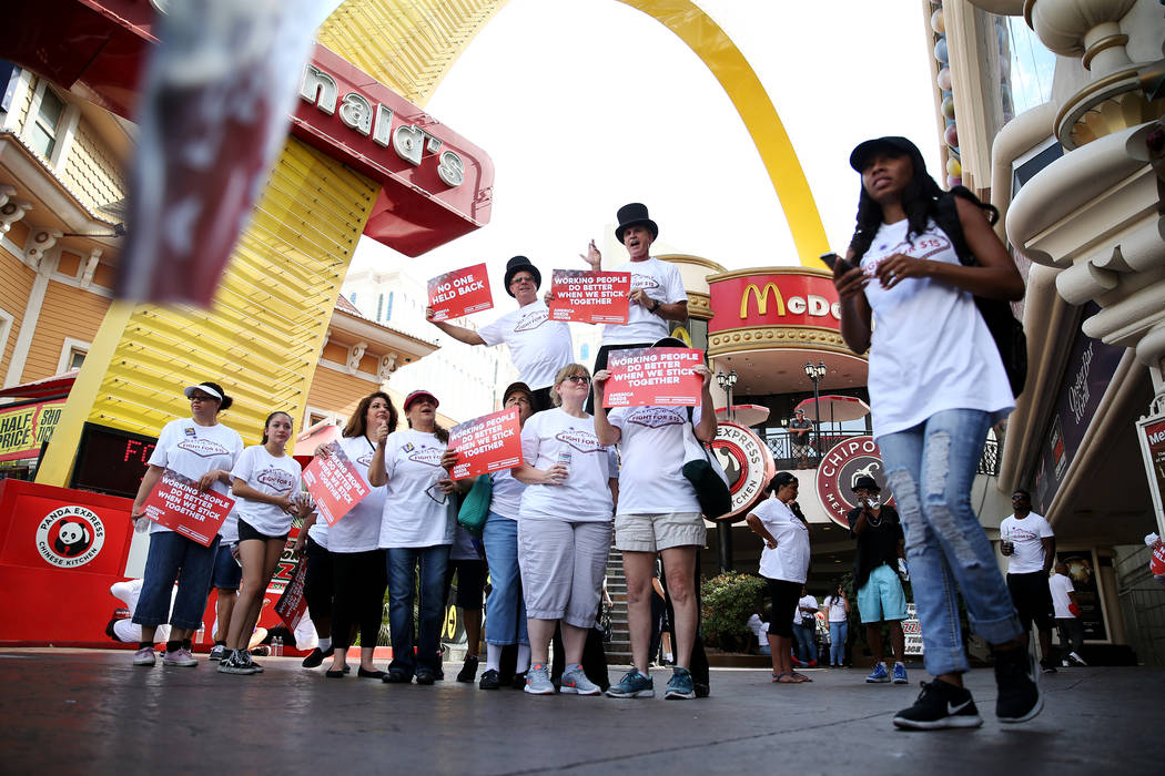 People participate during a Fight for $15 rally and march outside of the McDonald's near Harrah's hotel-casino in Las Vegas, on Monday, Sept. 4, 2017. Erik Verduzco Las Vegas Review- ...