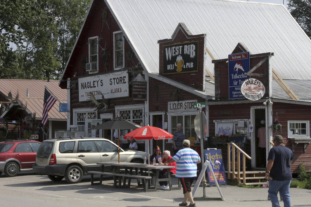 Tourists walk along historic Main Street in Talkeetna, Alaska, in July. (AP Photo/Mark Thiessen)