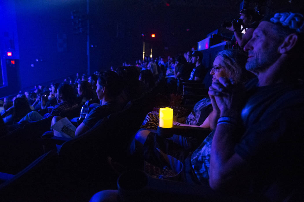 Linkin Park fans listen to Dead by Sunrise guitarist Ryan Shuck during a memorial for the singer and songwriter Chester Bennington at Saxe Theater on Saturday, Sept. 2, 2017, in Las Vegas. Shuck a ...