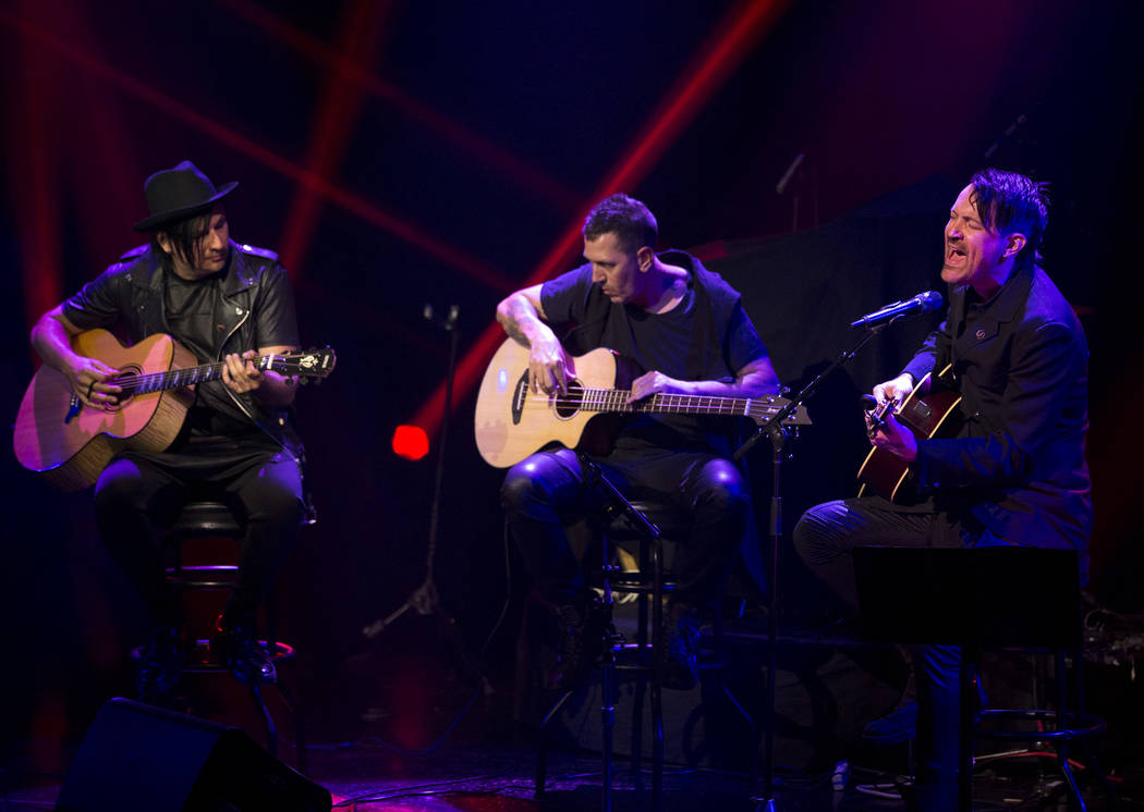 Amir Derakh, from left, Mace Beyers and Ryan Shuck perform during a memorial for singer and songwriter Chester Bennington at Saxe Theater on Saturday, Sept. 2, 2017, in Las Vegas. Shuck and Derakh ...