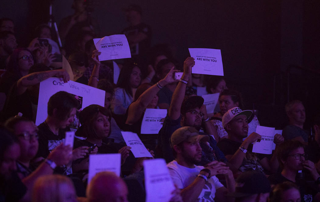 Linkin Park fans hold up signs during a memorial for the singer and songwriter Chester Bennington at Saxe Theater on Saturday, Sept. 2, 2017, in Las Vegas. Linkin Park canceled their upcoming &amp ...