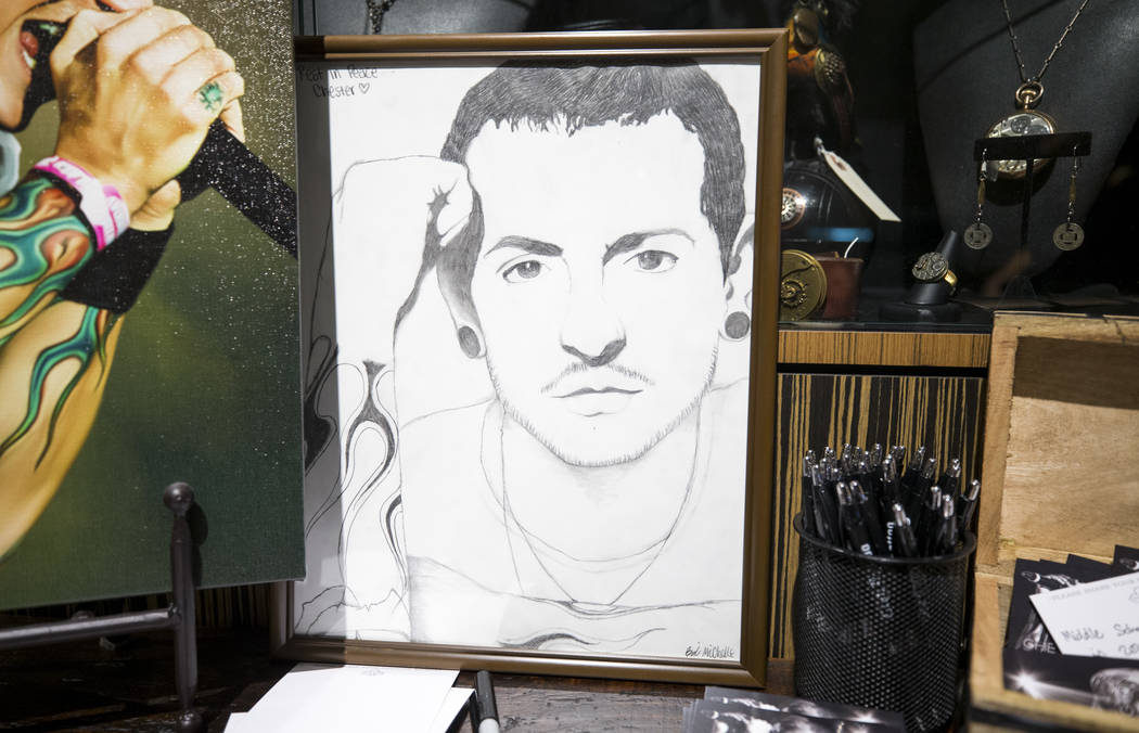 A sketch of singer and songwriter Chester Bennington sits at a memorial at Club Tattoo inside Planet Hollywood on Saturday, Sept. 2, 2017, in Las Vegas following a memorial for Bennington at the S ...
