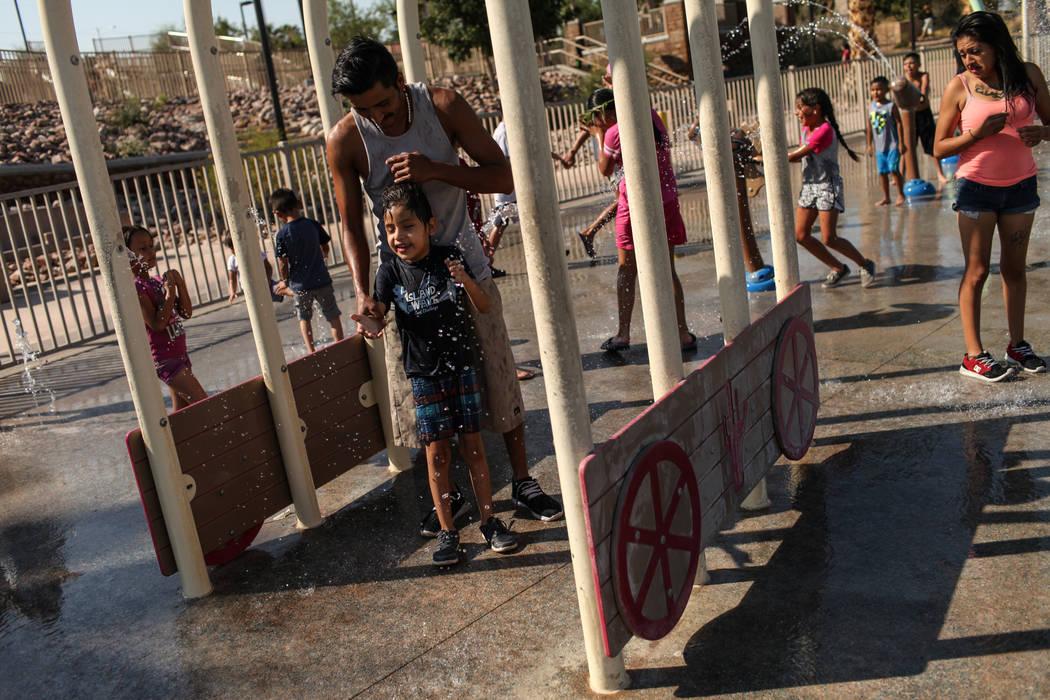 Jose Rodriguez plays with his son Angel, 7, at Lorenzi Park in Las Vegas, Sunday, Sept. 3, 2017. Joel Angel Juarez Las Vegas Review-Journal @jajuarezphoto