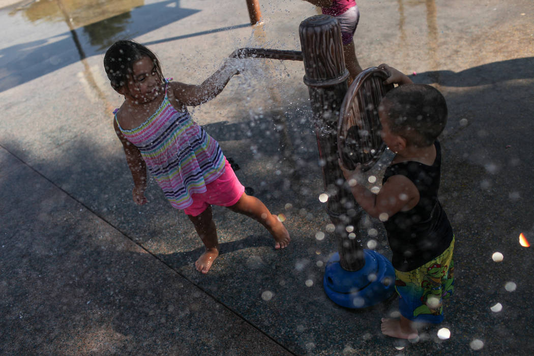 Gianna Aliza Ortega, 3, and Julian Margarito Ortega, 2, play at Lorenzi Park in Las Vegas, Sunday, Sept. 3, 2017. Joel Angel Juarez Las Vegas Review-Journal @jajuarezphoto
