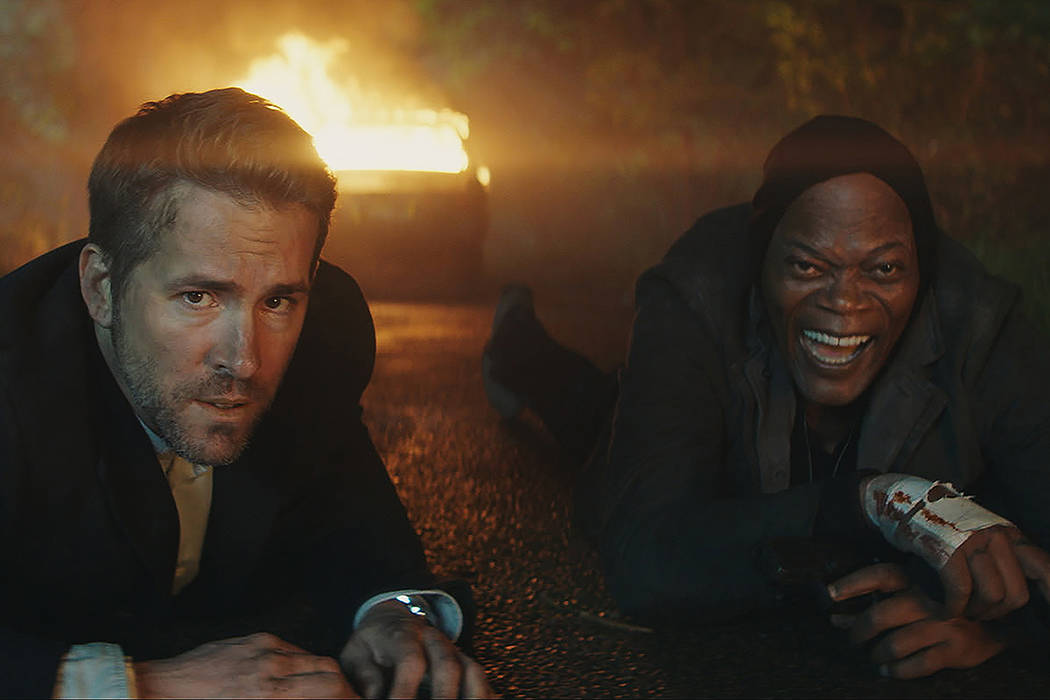 "Michael Bryce (Ryan Reynolds) and Darius Kincaid (Samuel L. Jackson) in ""The Hitman's Bodyguard."" (Lionsgate Entertainment)"