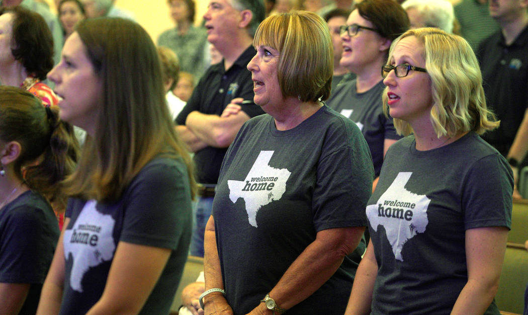 Sugar Land Baptist Church members wearing shirts with the outline of the state of Texas sing at church services in southwestern Houston, Sept. 3, 2017. (Rick Wilking/Reuters)