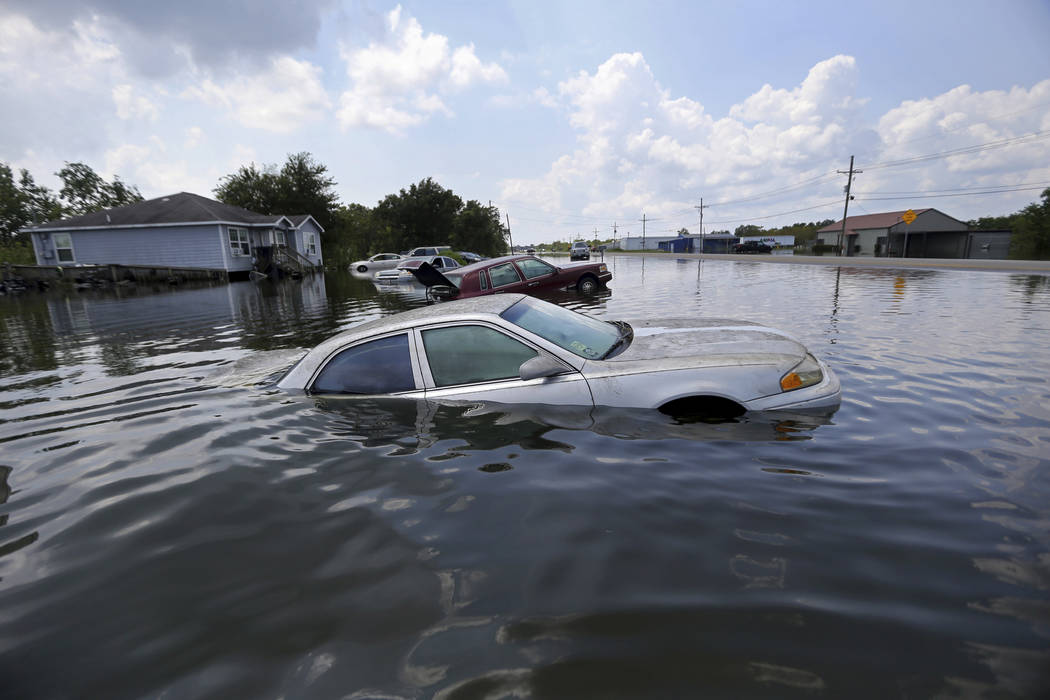 Flooded cars sit alongside a roadway in the aftermath of Tropical Storm Harvey, in Port Arthur, Texas, Saturday, Sept. 2, 2017. (Gerald Herbert/AP)