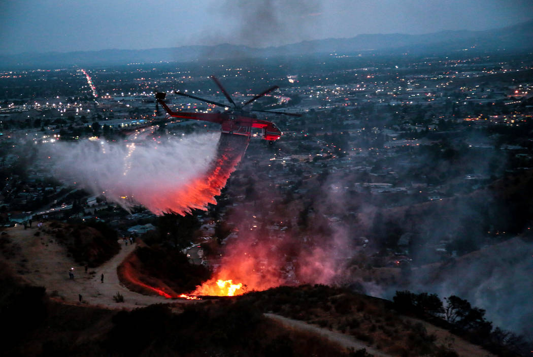 Water is dropped above homes in Sun Valley during the La Tuna Canyon fire over Burbank, California, Sept. 2, 2017. (Kyle Grillot/Reuters)