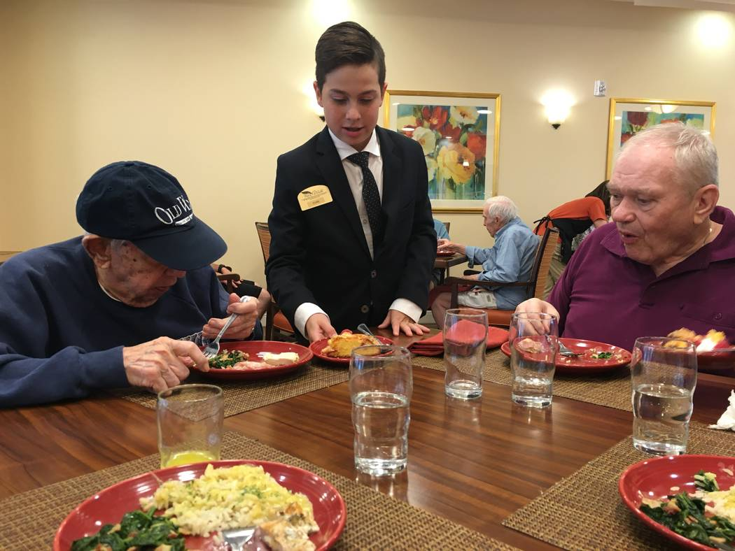 Stark delivers dessert plates to two Poet's Walk residents. (Diego Mendoza-Moyers / View)