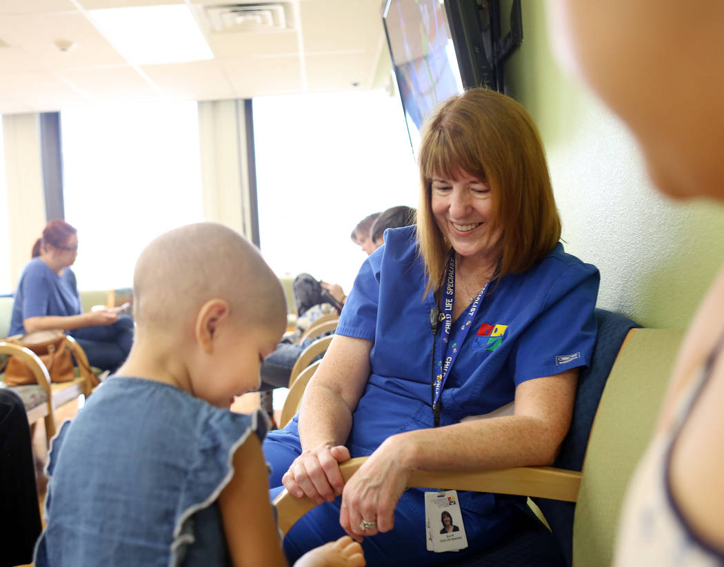 Sue Collins Waltermeyer, a child life specialist, plays with patient Madilyn Cash, 4, at the Children's Specialty Center of Nevada in Las Vegas, Tuesday, Sept. 5, 2017. (Elizabeth Brumley/Las Vega ...