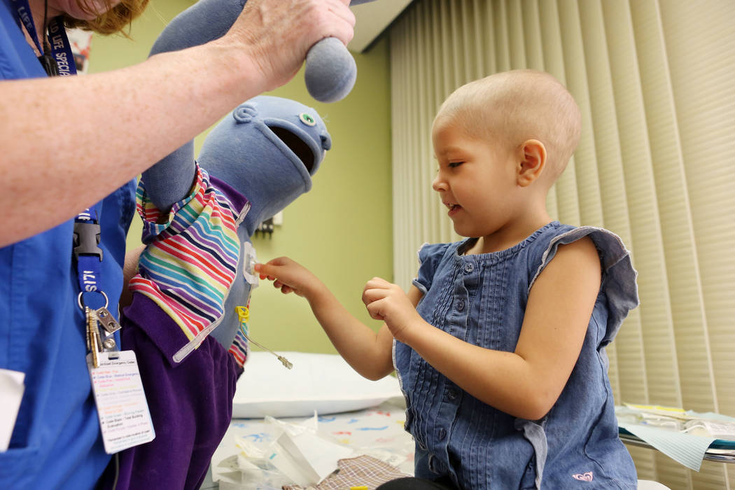 Leukemia patient Madilyn Cash, 4, treats her shadow buddy doll at the Children's Specialty Center of Nevada in Las Vegas, Tuesday, Sept. 5, 2017. Shadow buddies are used to help patients cope and  ...