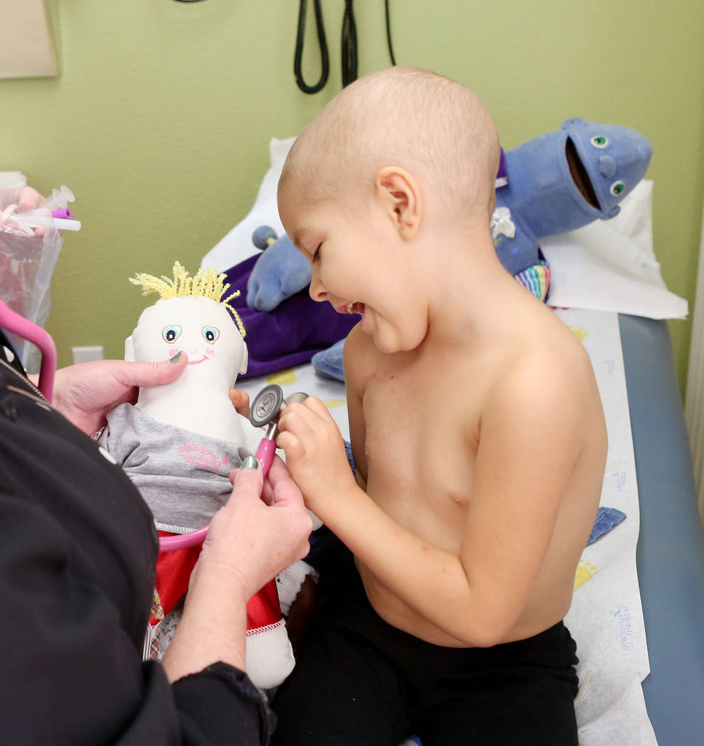 Leukemia patient Madilyn Cash, 4, checks her shadow buddy's heart rate at the Children's Specialty Center of Nevada in Las Vegas, Tuesday, Sept. 5, 2017. Shadow buddies are used to help patients c ...