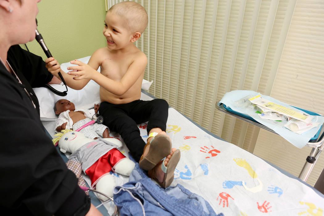 Leukemia patient Madilyn Cash, 4, checks Nurse Practitioner Arlene Bayreder's ears at the Children's Specialty Center of Nevada in Las Vegas, Tuesday, Sept. 5, 2017. Elizabeth Brumley Las Vegas Re ...
