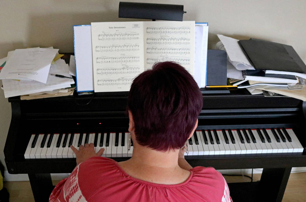 School teacher Maggie Mooha plays the piano at her home in North Las Vegas, Wednesday, Sept. 6, 2017. Mooha has been playing the piano for over 50 years. Gabriella Benavidez Las Vegas Review-Journ ...