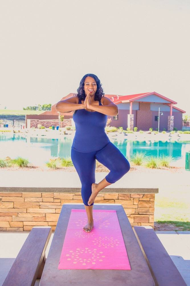 Amea Givens, founder of Optimize to Reset Your Health and Well Mornings with Medis, doing yoga. (Courtesy of Amea Givens)
