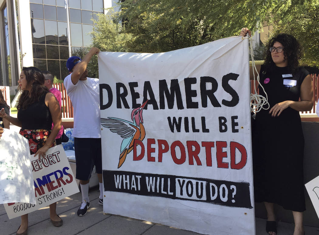 Immigrant rights groups, advocating for DACA, the program that allows youths who were brought to the country illegally as children to legally work and be shielded from deportation, rally in Phoeni ...