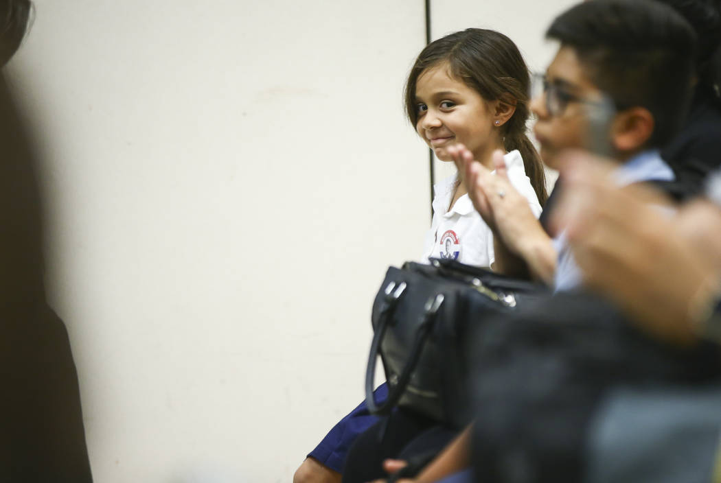 Six-year-old Giuliana Levine listens as members of a panel respond to her question during an event held by Latinos Unidos at Pearson Community Center in North Las Vegas on Thursday, Aug. 31, 2017. ...