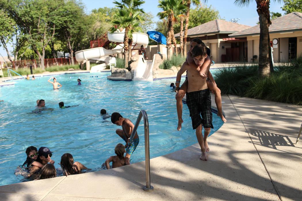 Caden Engler, 13, carries Nava Moore, 9, on his back at the Willows Community Center in Las Vegas, Monday, Sept. 4, 2017. Joel Angel Juarez Las Vegas Review-Journal @jajuarezphoto