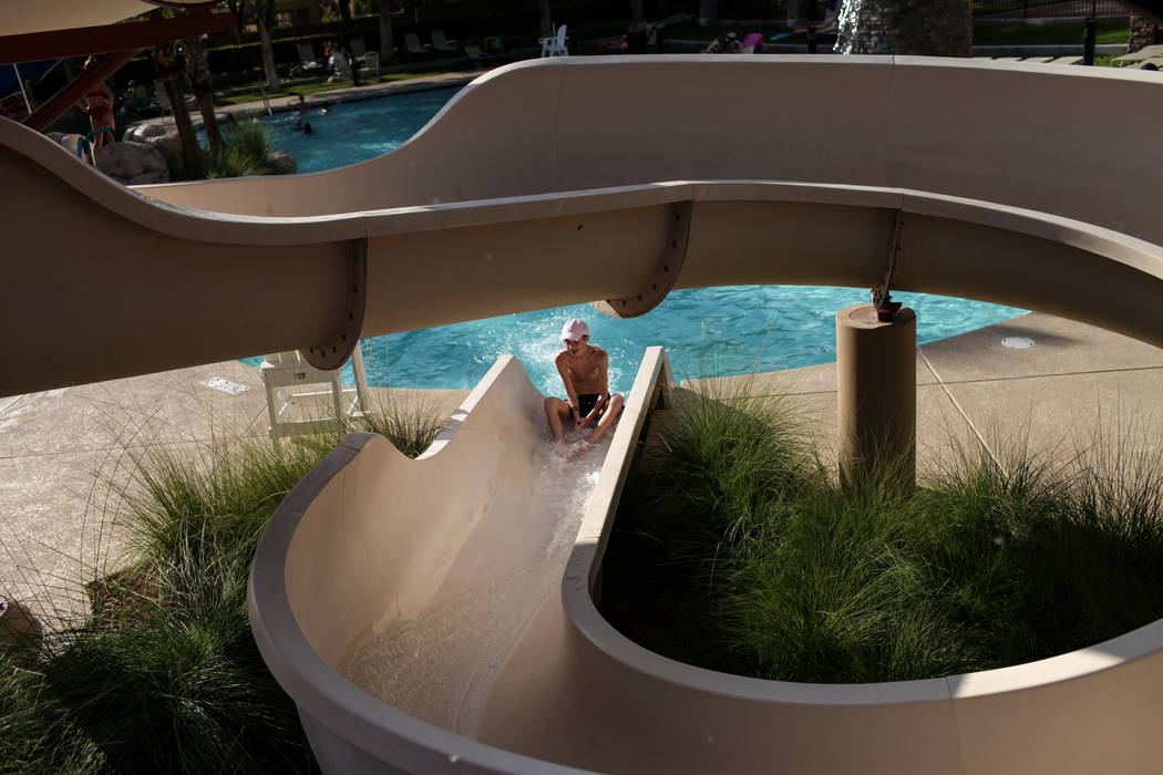 Caden Engler, 13, rides down a water slide at the Willows Community Center in Las Vegas, Monday, Sept. 4, 2017. Joel Angel Juarez Las Vegas Review-Journal @jajuarezphoto
