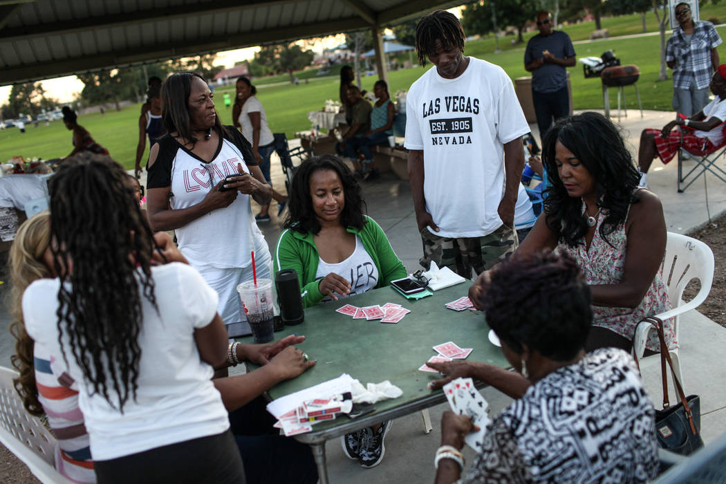 The Tolefree family plays a game of spades during a Labor Day barbecue at Lorenzi Park in Las Vegas, Monday, Sept. 4, 2017. Joel Angel Juarez Las Vegas Review-Journal @jajuarezphoto