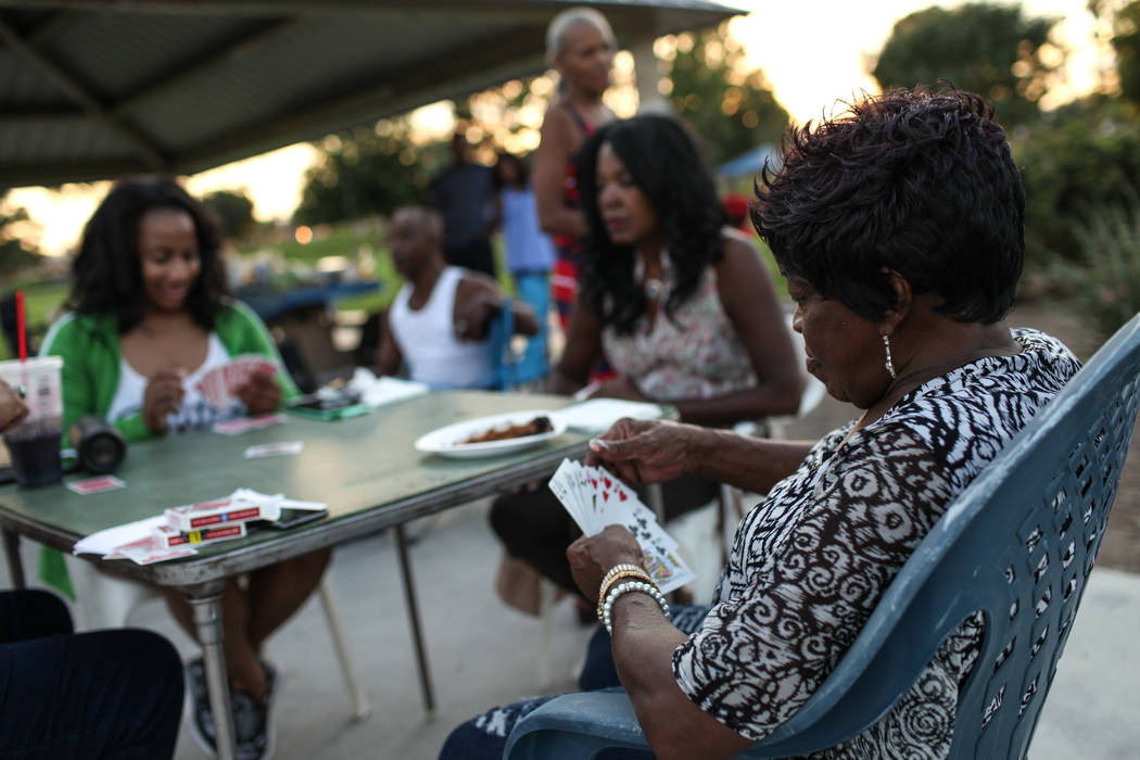 Eddie Finks plays a game of spades with family during a Labor Day barbecue at Lorenzi Park in Las Vegas, Monday, Sept. 4, 2017. Joel Angel Juarez Las Vegas Review-Journal @jajuarezphoto